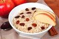 Apple cinnamon oatmeal bowl of breakfast with apples raisins and Royalty Free Stock Photo