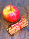 Apple and cinnamon red on wooden background Stock Photography