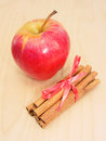 Apple and cinnamon red on wooden background Stock Photos