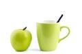 Apple and coffee mug isolated green Royalty Free Stock Image