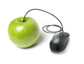 Apple with a computer mouse attached green black at the stem isolated on white background Stock Photo