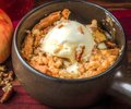Apple crisp a la mode freshly baked with walnut topping delicious seasonal dessert Stock Image