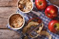 Apple crumble in portion pots horizontal top view on the table of rustic style Stock Photography