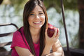 An apple a day cute young woman eating and smiling Royalty Free Stock Photography