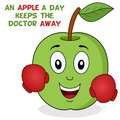 An apple a day keeps the doctor away cheerful cartoon green character smiling and wearing boxing gloves isolated on white Royalty Free Stock Image