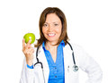 An apple a day keeps the doctor away closeup portrait happy smiling health care professional female family physician with Royalty Free Stock Photography
