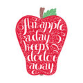 An apple a day keeps the doctor away lettering in apple. Stamp design. Royalty Free Stock Photo