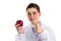 Apple a day keeps the doctor away old saying an acne skin child with medical white coat is showing juicy red making success sign Stock Image