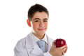 Apple a day keeps the doctor away old saying an acne skin child with medical white coat is showing juicy and tasty red reminding Stock Image