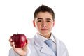 Apple a day keeps the doctor away old saying an acne skin child with medical white coat is showing juicy and tasty red reminding Royalty Free Stock Photos