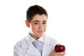 Apple a day keeps the doctor away old saying an acne skin child with medical white coat is showing juicy and tasty red reminding Stock Photography