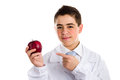 Apple a day keeps the doctor away old saying an acne skin child with medical white coat is showing juicy and tasty red reminding Royalty Free Stock Image
