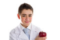 Apple a day keeps the doctor away old saying an acne skin child with medical white coat is showing juicy and tasty red reminding Stock Photo