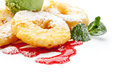 Apple dessert slices fried in batter with a scoop of ice cream and fruit topping Royalty Free Stock Photography