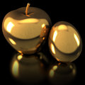 Apple and egg antique gold on black background Royalty Free Stock Images