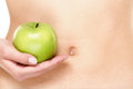 Apple fruits and stomach health concept eating healthy is good for digestion woman showing green Royalty Free Stock Image