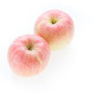 Apple fuji fruit with water drops on white background Royalty Free Stock Photography