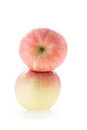 Apple fuji fruit with water drops on white background Stock Images