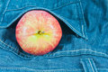 Apple in genes pocket Royalty Free Stock Image