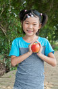 Apple girl the little with a red Royalty Free Stock Images
