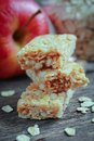 Apple granola barre three with fruits in background Royalty Free Stock Photos