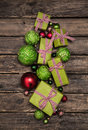 Apple green christmas presents with a red white check ribbon on