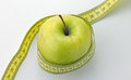 Apple a green with measuring tape Stock Photos
