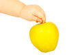 Apple in a hand yellow child on white background Royalty Free Stock Image