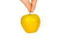 Apple in a hand yellow on white background Royalty Free Stock Image