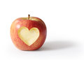 Apple with heart shape isolated on white background Stock Photos