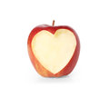 Apple with heart shape isolated on white background Stock Image