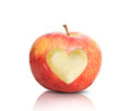 Apple with heart shape on wood background Royalty Free Stock Image