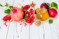 Apple and honey, traditional food of jewish New Year - Rosh Hashana. Copy space background. Royalty Free Stock Photo