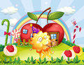 Apple houses at the hilltop at the back of the playful monster illustration Royalty Free Stock Images