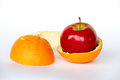 Apple inside an orange gmo are living organisms whose genetic material has been altered to enhance some qualities over others Royalty Free Stock Photos