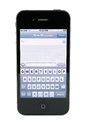 Apple iPhone 4s text message Royalty Free Stock Image