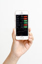Apple iPhone 5s color gold showing Bloomberg app. Royalty Free Stock Photo
