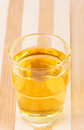 Apple juice in glass on cutting board Stock Image