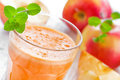 Apple juice in a glass and fresh fruits Royalty Free Stock Images