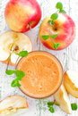 Apple juice in a glass and fresh fruits Royalty Free Stock Photography