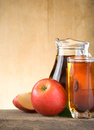 Apple juice in glass and slices on wood Royalty Free Stock Image