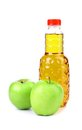Apple juice in plastic bottle and two apples on a white Stock Images