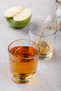 Apple juice two glasses of and green on the ceramic surface Stock Image