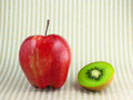 Apple and kiwi fruit a red delicious a fresh sliced tasty green on stylish kitchen paper Royalty Free Stock Photos
