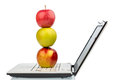 Apple lies on a keyboard an is computer symbolic photo for healthy and vitamin rich snack Royalty Free Stock Image
