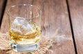 Apple liqueur shot close up on dark wooden background Stock Photo