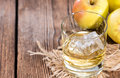 Apple liqueur shot close up on dark wooden background Stock Photos