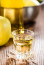 Apple liqueur shot close up on dark wooden background Royalty Free Stock Photos