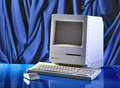 Apple macintosh classic brussel belgium circa year old fashioned computer and mouse on office desk model from Royalty Free Stock Photo