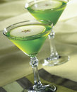 Apple martini in glasses on green background Stock Photography